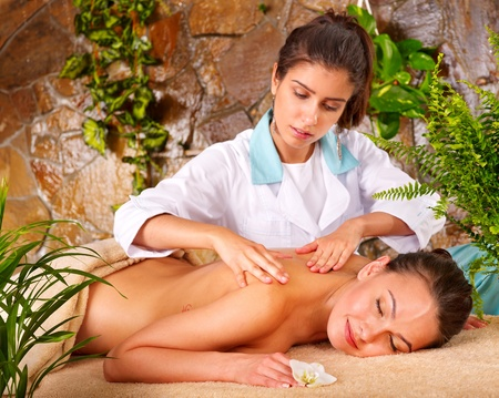 Beautiful young woman getting massage in spa. Stock Photo - 9899457