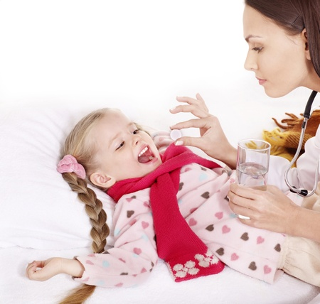 Sick child take  medicine with doctor. Isolated. Stock Photo - 9972526