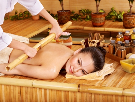 body conscious: Young woman getting bamboo massage. Stock Photo