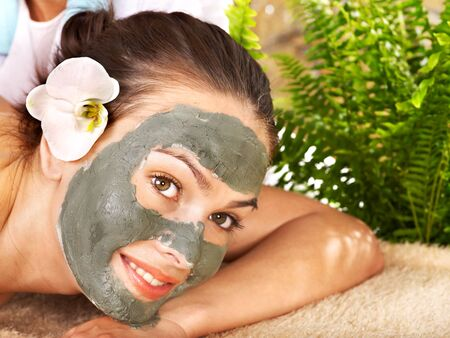 Beautiful girl having clay body mask apply by beautician. Stock Photo - 9972621
