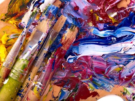 Close up of oil paint mixed on  palette. photo