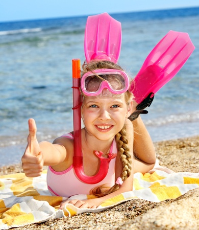 sky dive: Little girl  playing on  beach.