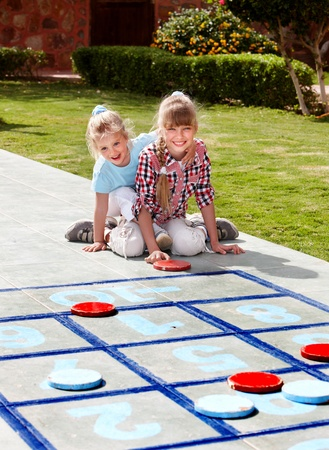 hopscotch: Children playing in golf. Kids outdoor games. Stock Photo