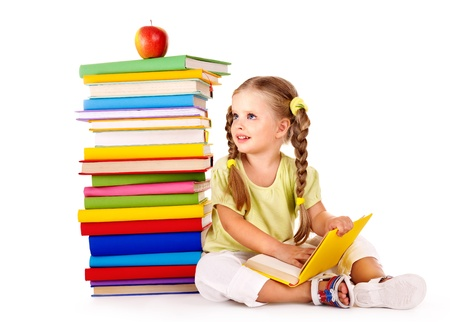 pigtails: Little girl reading  pile of books. Isolated. Stock Photo