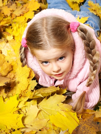 Child in autumn orange leaves. Outdoor. Stock Photo - 10225191