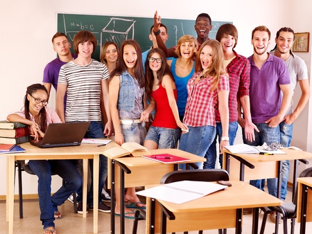 Group student in classroom near blackboard. Stock Photo - 10226233