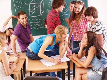Group student in classroom near blackboard. Stock Photo - 10226235