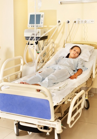 Sick patient on gurney in operating room. Stock Photo - 10225070