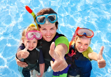 super woman: Children with mother  in swimming pool learning snorkeling.