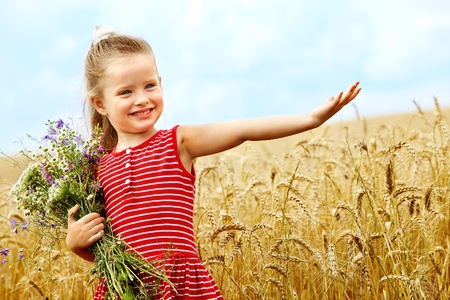 Child in wheat field. Outdoor. photo