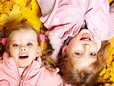 Children in autumn orange leaves. Outdoor. Stock Photo - 10300982