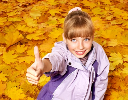 Child in autumn orange leaves. Outdoor. Stock Photo - 10300935