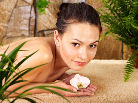 skin treatment: Beautiful young woman getting massage in spa. Stock Photo