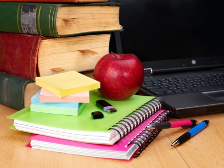 Books and laptop. School supplies.. Back to school. photo