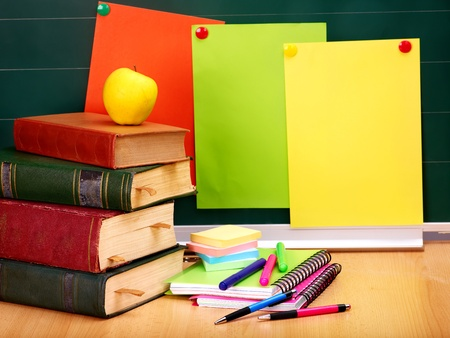 Books and blackboard. School supplies.. Back to school. photo