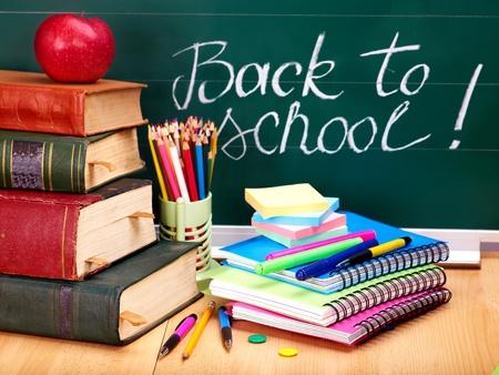 writing utensil: Books and blackboard. School supplies.. Back to school.