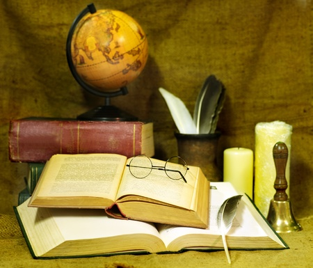 studing: Stack old book and candle. Education. Stock Photo