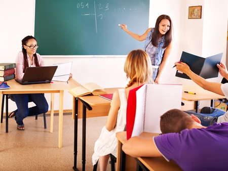 Group student in classroom near blackboard. Stock Photo - 10292135