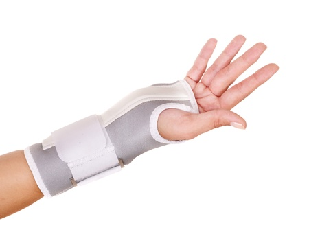 Trauma of wrist in brace. Isolated. Stock Photo - 10301086