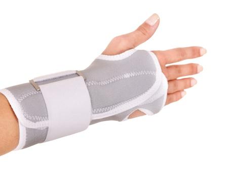 Trauma of wrist in brace. Isolated. photo
