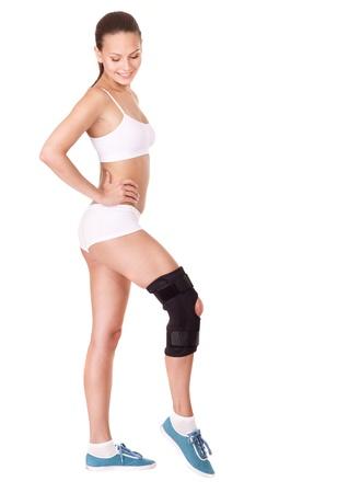 splint: Girl with trauma of knee in brace.. Isolated.