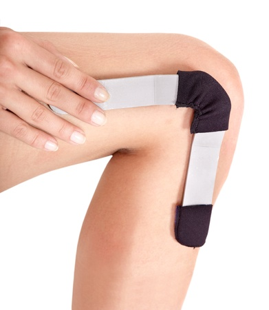 Trauma of  knee in hinged  brace. Isolated. Stock Photo - 10301075