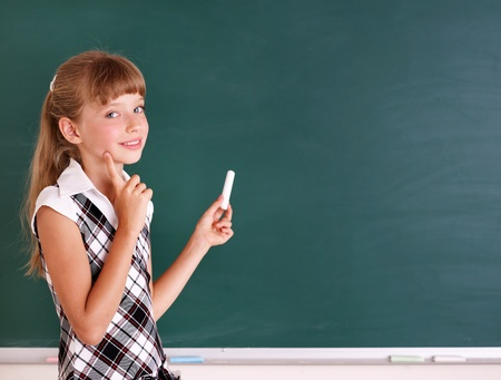 Happy schoolchild writing on blackboard. Stock Photo - 10292154