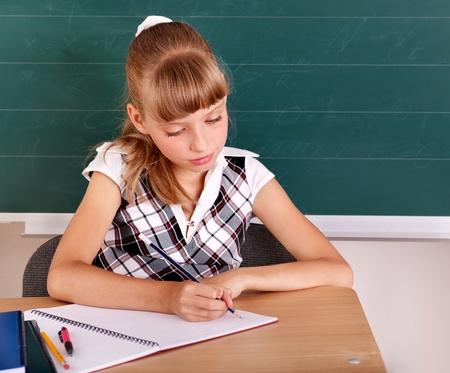 Happy schoolchild in classroom near blackboard. Stock Photo - 10292500