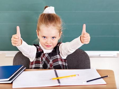 Happy schoolchild in classroom near blackboard. Stock Photo - 10292538