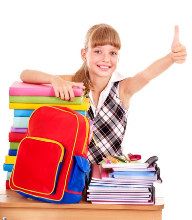 office supply: Schoolgirl with stack of books and showing thumb up. Isolated.