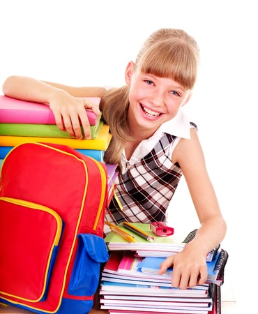 back to school supplies: School child holding stack of books.  Isolated.