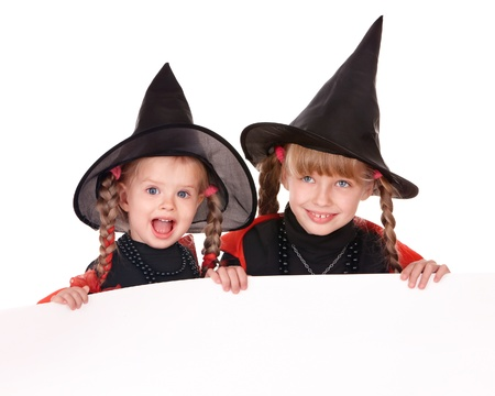 halloween witch: Little girl  witch holding banner . Isolated. Stock Photo