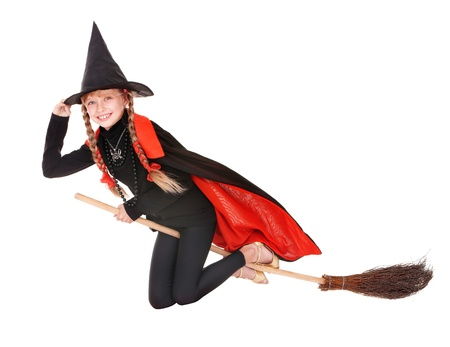 broom: Little girl in costume Halloween witch in black dress and hat fly on broom.Isolated.