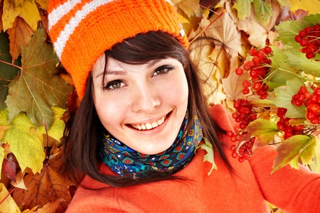 Young woman in autumn orange leaves. Outdoor. photo