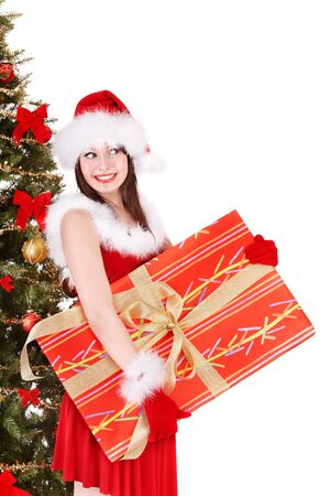Girl in santa hat holding gift box by christmas tree.  Isolated. Stock Photo - 10533259