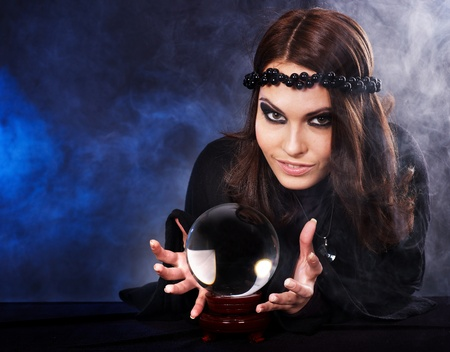 fortune telling: Young woman with crystal ball. Fortune telling.