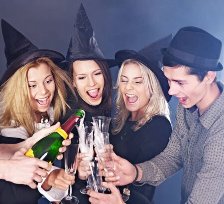 Group young people at nightclub drinking  champagne. photo