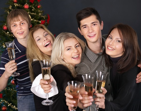 Group young people drink champagne at nightclub. photo