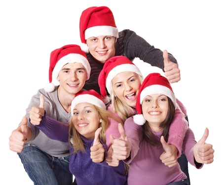 Group young people in santa hat showing thumb up. Isolated. photo