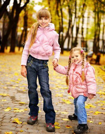 Child in autumn orange leaves. Outdoor. Stock Photo - 10563525