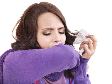 sneeze: Young woman with handkerchief having  cold. Isolated.