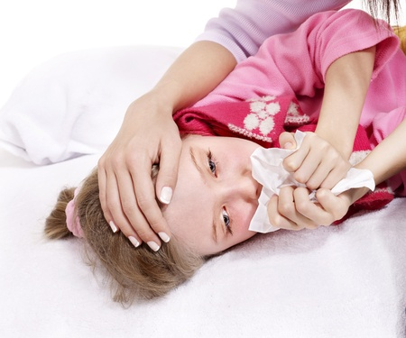 Sick little girl with handkerchief in bed. photo
