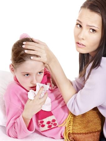 Sick little girl with handkerchief in bed. photo