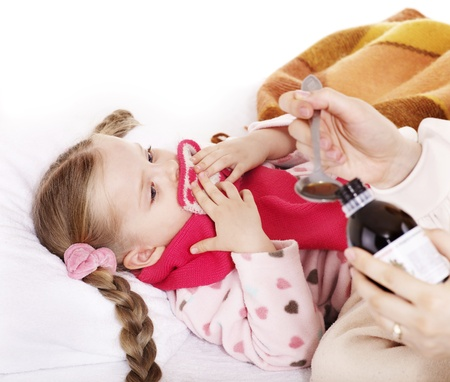 Sick child refuse to take  medicine. Isolated. photo