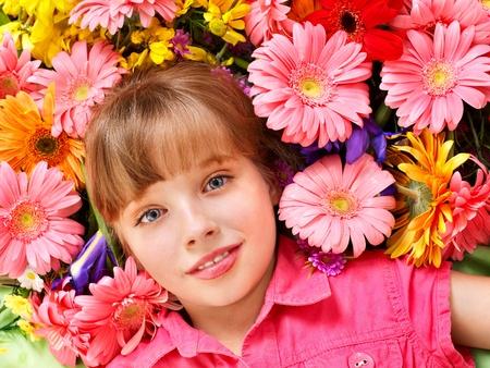 Little cute girl lying  on the flower. photo
