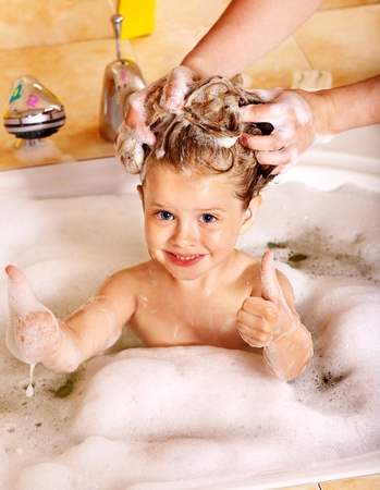 Child washing hair in bubble bath. Stock Photo - 10533477