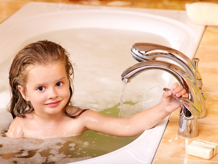 Child washing in bubble bath . Stock Photo - 10533136