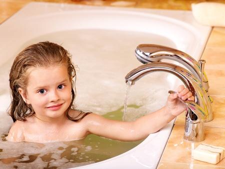 little girl bath: Child washing in bubble bath . Stock Photo
