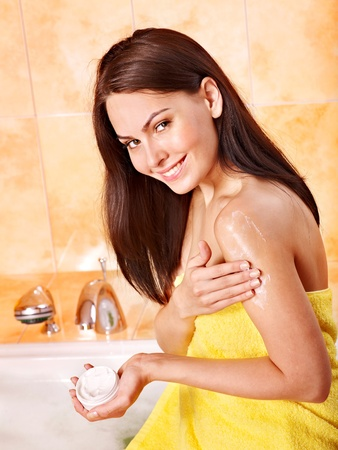 cosmetic cream: Young woman take bubble  bath.