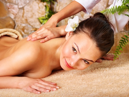 beauty parlour: Beautiful young woman getting massage in spa. Stock Photo